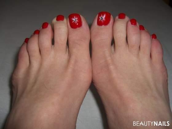 Männerfüsse in Rot Füsse