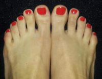 Orange Rote Fußnägel Füsse