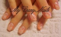 Weiss & Orange Sponge & Blumenstamping Nageldesign